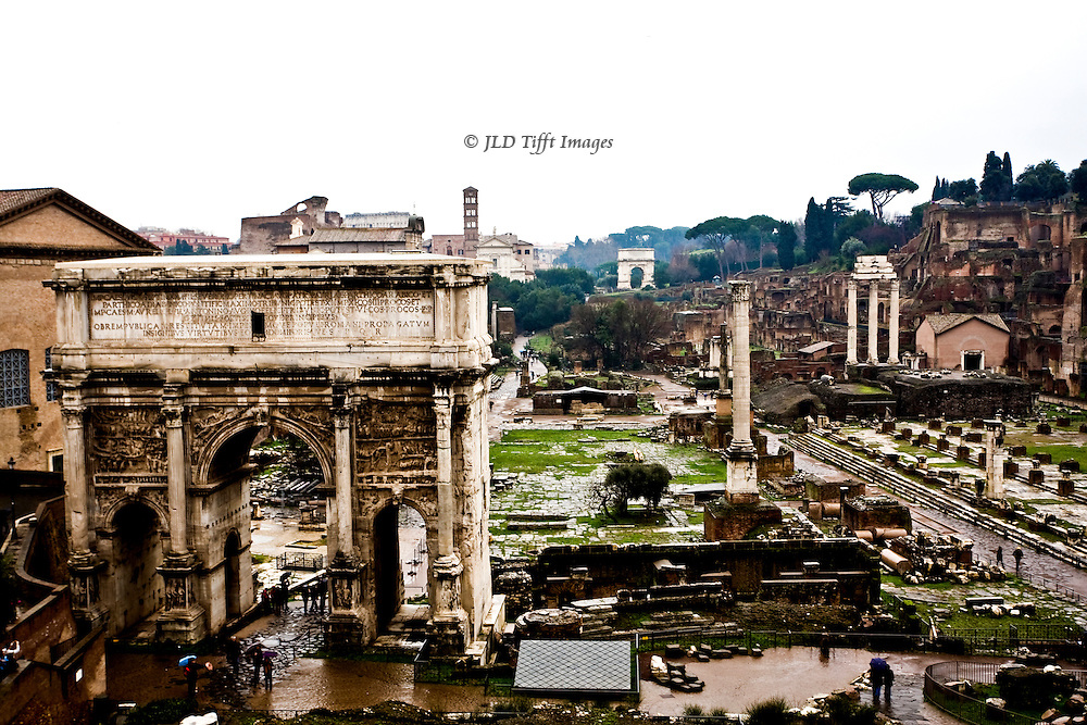 Overview of the Roman Forum from the vantage point at the back of the Capitoline Museum.  Visible are the Arch of Septimus Severus on the left, Column of Phocas, Basilica Julia, Temple of Castor and Pollux, Sacred Way, and Arch of Titus gleaming in the distance.