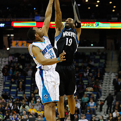 February 7, 2011; New Orleans, LA, USA; Minnesota Timberwolves guard Wayne Ellington (19) shoots over New Orleans Hornets shooting guard Willie Green (33) during the fourth quarter at the New Orleans Arena. The Timberwolves defeated the Hornets 104-92.  Mandatory Credit: Derick E. Hingle
