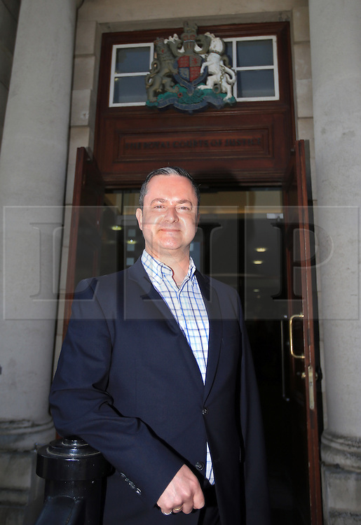 """© Licensed to London News Pictures. 9/05/2016. Belfast, Northern Ireland, UK. Gay rights activist Gareth Lee arrives at Belfast High Court for the start Appeal hearing over gay marriage cake row with Ashers Baking Company. The legal appeal by Ashers Baking Company in the controversial 'gay cake' case is to be heard over two days. In May last year a judge at Belfast County Court ruled that the bakery had acted unlawfully. The court ordered Ashers to pay £500 damages after Judge Isobel Brownlie said the customer had been treated """"less favourably"""" contrary to the law and the bakery had breached political and sexual orientation discrimination regulations. But the McArthur family who own and run Ashers decided to challenge the ruling following consultations with their legal advisors. The family has been given the full support of The Christian Institute, which has funded their defence costs. The legal case followed a decision in May 2014 by Ashers to decline an order placed at its Belfast store by a gay rights activist who asked for a cake featuring the Sesame Street puppets, Bert and Ernie, and the campaign slogan, 'Support Gay Marriage'. The customer also wanted the cake to feature the logo of a Belfast-based campaign group QueerSpace. Ashers, owned by Colin and Karen McArthur, refused to make the cake because it carried a message contrary to the family's firmly-held Christian beliefs. They were supported by their son Daniel, the General Manager of the company. But the Equality Commission for Northern Ireland (ECNI) launched a civil action against the family-run bakery, claiming its actions violated equality laws in Northern Ireland and alleging discrimination under two anti-discrimination statutes – The Equality Act (Sexual Orientation) Regulations (NI) 2006 and The Fair Employment and Treatment (NI) Order 1998. Photo credit : Paul McErlane/LNP"""