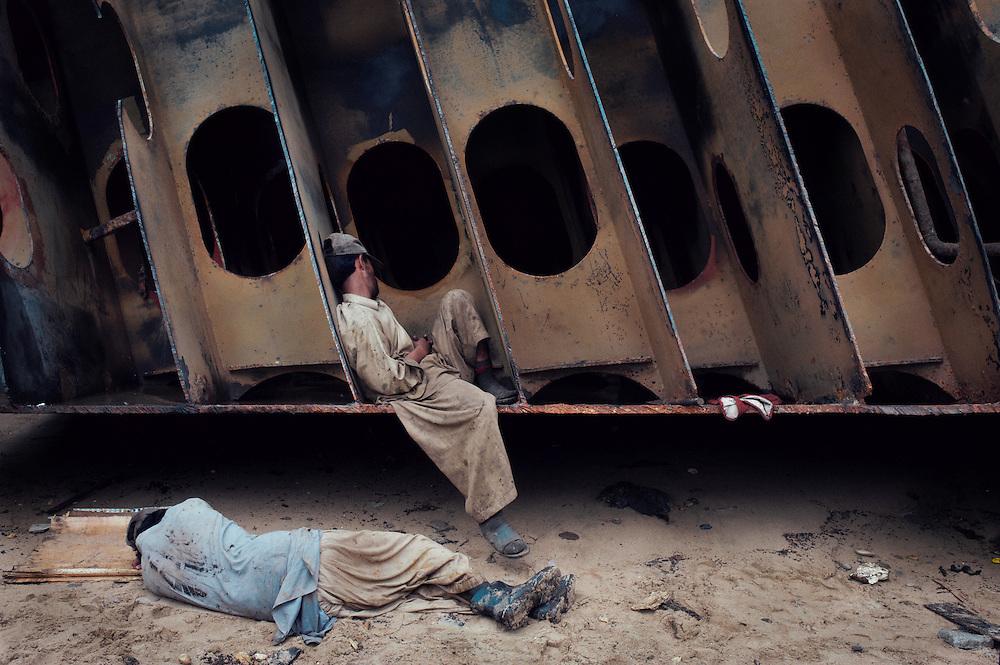 Men rest at the Gadani ship breaking yard, Balochistan Province, Pakistan on August 16, 2011.