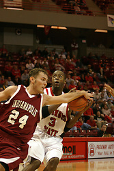 19 November 2005: Scott Strahm reaches back to get a clean hand on the ball controlled by Nedu Onyeuku. In a non-conference race that came down to a photo finish, the Illinois State Redbirds slipped past the Indianapolis University Greyhounds 54-50 at Redbird Arena in Normal Illinois