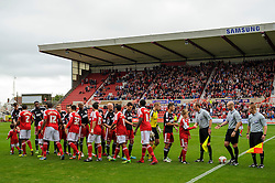 Bristol City players shake hands with Swindon before the first half of the match - Photo mandatory by-line: Rogan Thomson/JMP - Tel: 07966 386802 - 21/09/2013 - SPORT - FOOTBALL - County Ground, Swindon - Swindon Town v Bristol City - Sky Bet League 1.