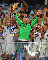 Goalkeeper Manuel Neuer of Germany lifts the FIFA World Cup trophy alongside his team mates after beating Argentina 1-0 and winning the FIFA World Cup Final