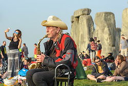 © Licensed to London News Pictures.21/06/2017. Stonehenge, Amesbury, Wiltshire, UK.  NIK TURNER (of Hawkwind) plays at the Summer Solstice celebrations at Stonehenge on the longest day of the year. Photo credit : Simon Chapman/LNP