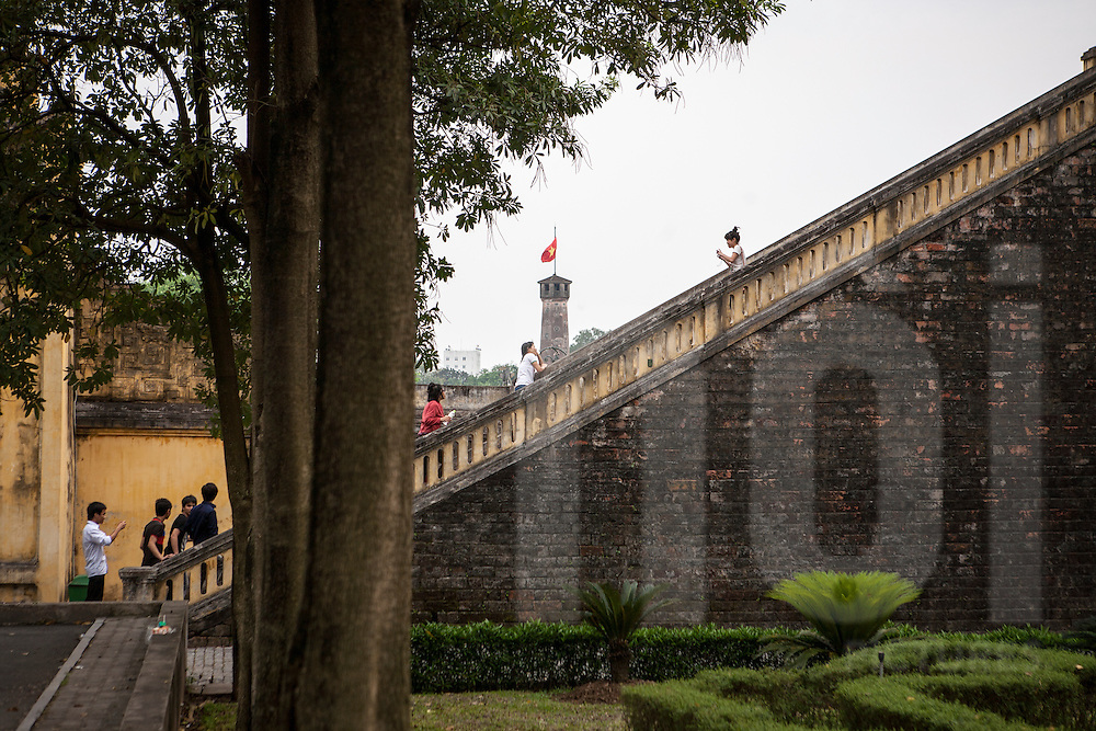Visitors are stepping on staircase to climb up Hanoi citadel. They are taking photos. Hanoi, Vietnam, Asia.