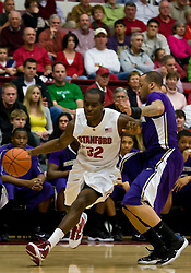February 13, 2010; Stanford, CA, USA;  Stanford Cardinal guard Da'Veed Dildy (32) is defended by Washington Huskies guard Scott Suggs (15) during the first half at Maples Pavilion.  Washington defeated Stanford 78-61.