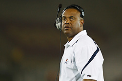 September 11, 2010; Los Angeles, CA, USA;  Virginia Cavaliers head coach Mike London on the sidelines against the Southern California Trojans during the fourth quarter at the Los Angeles Memorial Coliseum.  USC defeated Virginia 17-14.