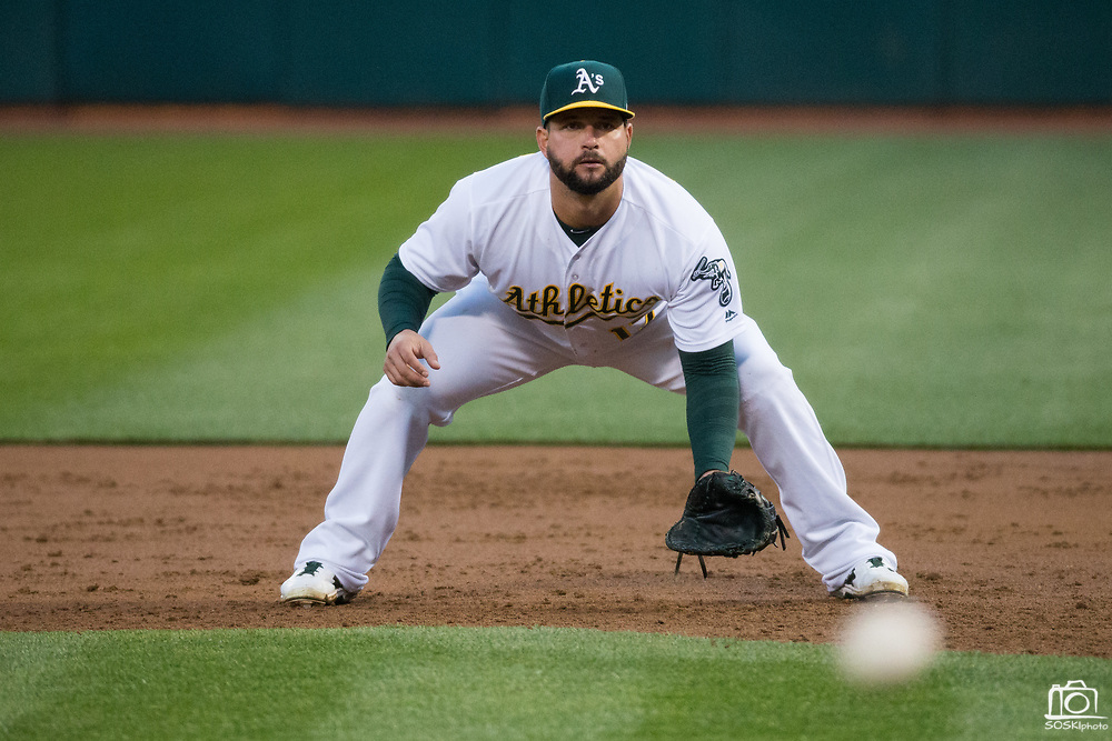 Oakland Athletics first baseman Yonder Alonso (17) watches a hit by the Miami Marlins at Oakland Coliseum in Oakland, Calif., on May 23, 2017. (Stan Olszewski/Special to S.F. Examiner)