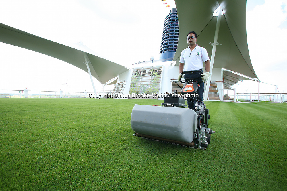 Celebrity Equinox feature photos..The Lawn being tended.
