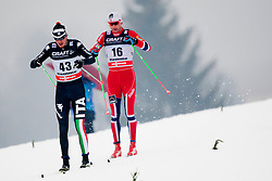 Dietmar Noecler of Italy behind him Nikals Dyrhaug of Norway during mens 10km Classic individual start of the Tour de Ski 2014 of the FIS cross country World cup on January 4th, 2014 in Cross Country Centre Lago di Tesero, Val di Fiemme, Italy. (Photo by Urban Urbanc / Sportida)