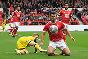 Burton Albion midfielder Jamie Allen (4) tackles Nottingham Forest defender Eric Lichaj (2) for the ball during the EFL Sky Bet Championship match between Nottingham Forest and Burton Albion at the City Ground, Nottingham, England on 21 October 2017. Photo by Richard Holmes.