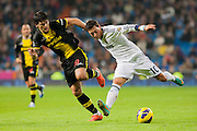 Ozil challenging for the ball