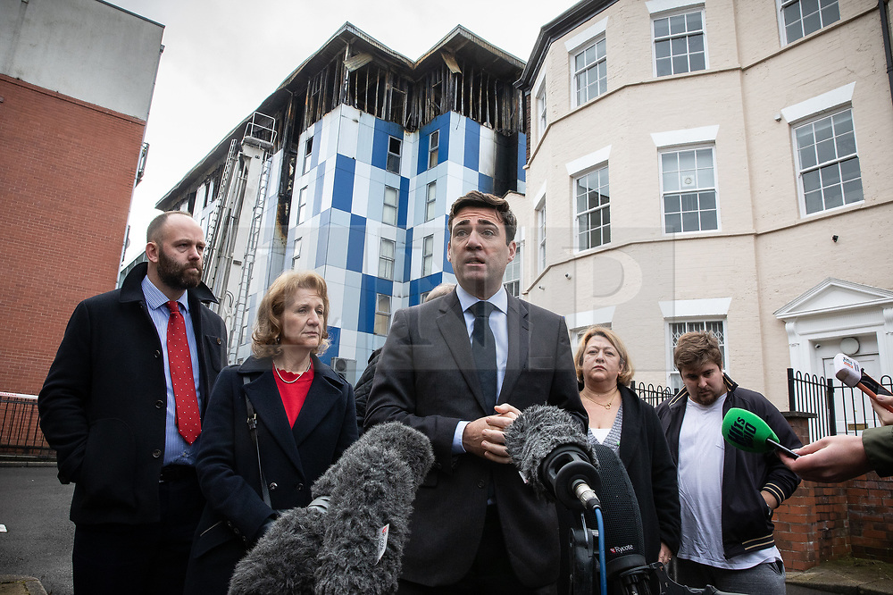 "© Licensed to London News Pictures. 16/11/2019. Bolton, UK. PAUL DENNETT of Greater Manchester's High Rise Taskforce , Deputy Mayor of Greater Manchester BEV HUGHES , Mayor of Manchester ANDY BURNHAM and SANDRA RUIZ and TIAGO ALVES of Grenfell United, both of whom are former Grenfell Tower residents , at a press conference at the site of the blaze . Firefighters work at the scene where a fire broke out overnight (15th/16th November 2019) at a block of flats known as "" The Cube "" , in Bolton Town Centre . At least two people are known to have been treated by paramedics at the scene of the six-story block , which is occupied by students of the University of Bolton . Photo credit: Joel Goodman/LNP"