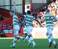 09/11/14 SCOTTISH PREMIERSHIP <br /> ABERDEEN v CELTIC <br /> PITTODRIE - ABERDEEN<br /> Celtic's Stefan Johansen (left) celebrates with his team-mates Emilio Izaguirre and Scott Brown having scored the equaliser