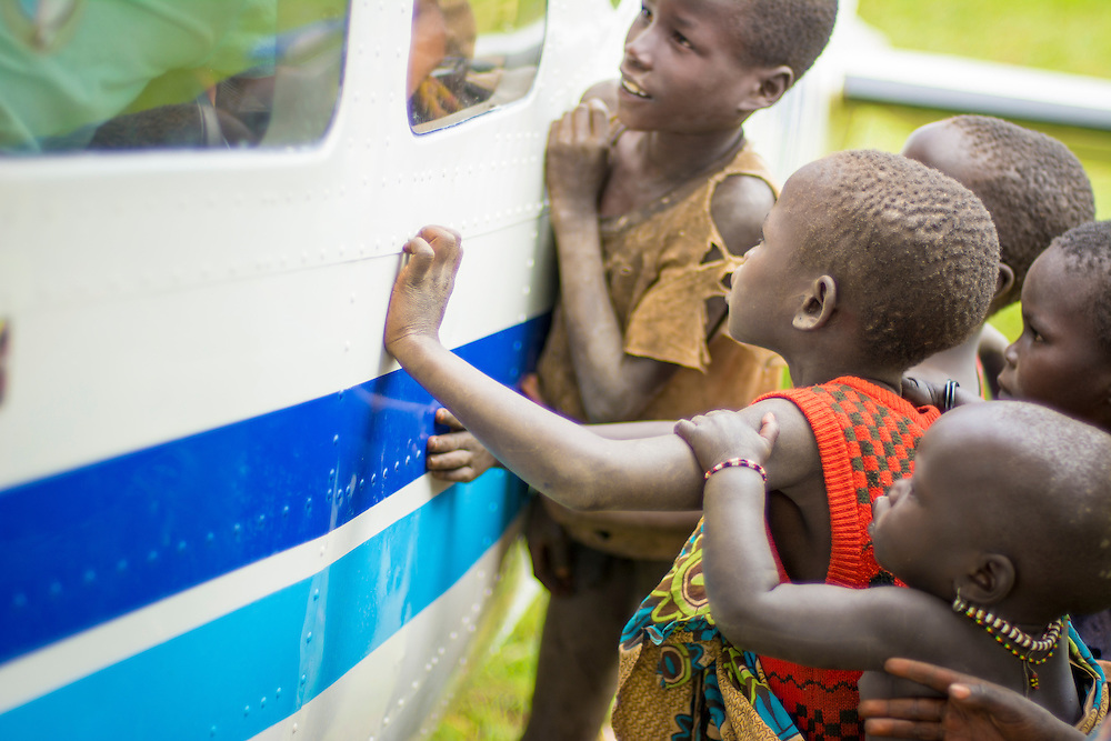 Curious children inspect the 206 in Nagishot, South Sudan.