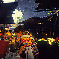 Central America, Latin America, Guatemala, Chichicastenango. Woman cooks a meal in the Chichicastenango Market.