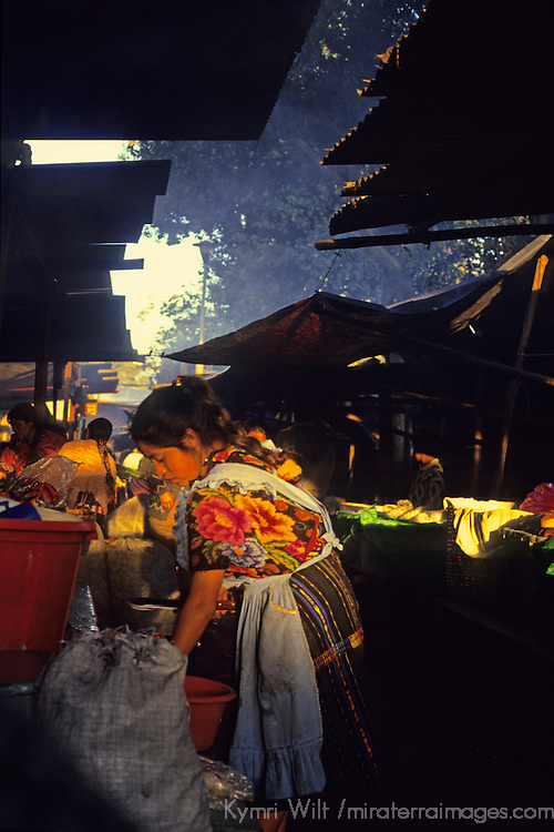 Central America, Latin America, Guatemala, Chichicastenango. Woman cooks a meal in the Chichicastenango Market.