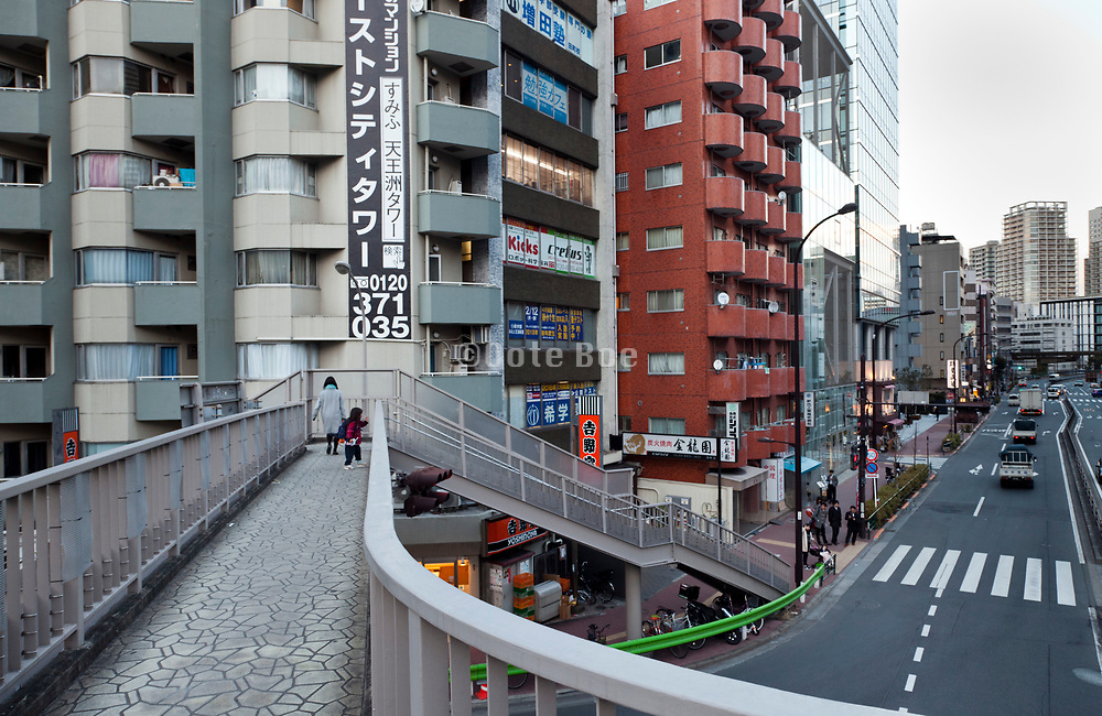 mother and child on a pedestrian walking bridge in the Shibaura district Tokyo