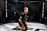 "LONDON, ENGLAND, MARCH 5, 2014: Gunnar Nelson limbers up during the media open work-out sessions for ""UFC Fight Night: Gustafsson vs. Manuwa"" inside One Embankment London, England (Martin McNeil for ESPN)"
