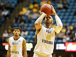 Dec 20, 2017; Morgantown, WV, USA; West Virginia Mountaineers guard Jevon Carter (2) shoots a foul shot during the second half against the Coppin State Eagles at WVU Coliseum. Mandatory Credit: Ben Queen-USA TODAY Sports