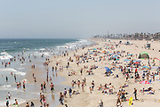 holiday makers on the Huntington Beach, California