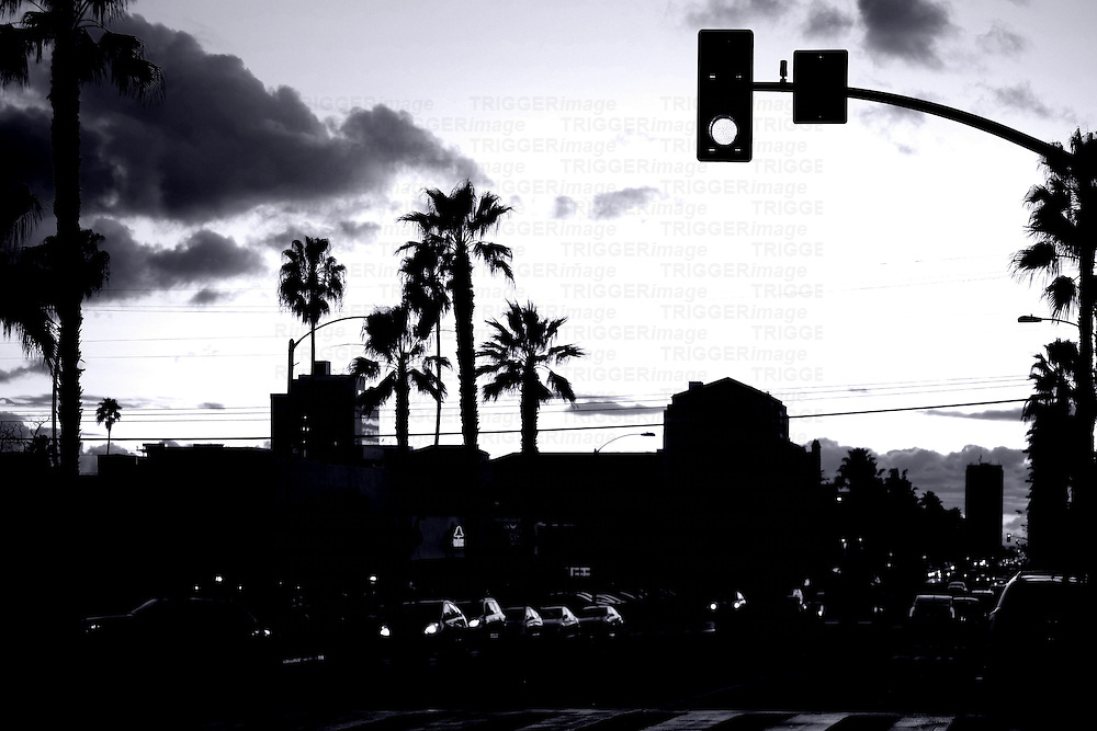 Road traffic on Santa Monica Boulevard during the sunset.