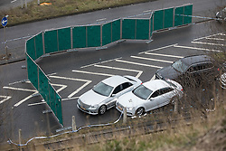 © Licensed to London News Pictures. 03/01/2017. Huddersfield, UK. A screen erected to block the view of a bullet riddled silver Audi car at the slip road at Junction 24 of the M62 motorway in Huddersfield . West Yorkshire police have announced a man has died following the discharge of a police firearm , during what they describe as a pre-planned operation , yesterday evening (2nd January 2017) . Photo credit : Joel Goodman/LNP