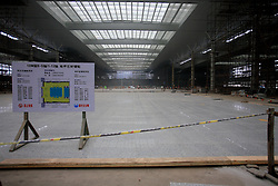 CHINA SHANGHAI HONGQIAO 19MAY10 - Construction site of the Hongqiao Passenger Rail Terminal in Shanghai, China. There are a total of 23000 solar panels planned for the CECIC-funded project, each panel with a production capacity of 280 KWh to feed into the electricity grid...jre/Photo by Jiri Rezac..© Jiri Rezac 2010