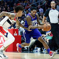 09 December 2017: LA Clippers guard Lou Williams (23) drives past Washington Wizards forward Kelly Oubre Jr. (12) during the LA Clippers 113-112 victory over the Washington Wizards, at the Staples Center, Los Angeles, California, USA.