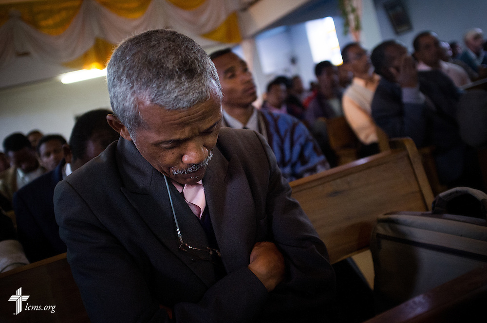 A man prays during the opening of the synodical convention for the Fiangonana Loterana Malagasy near Antsirabe, Madagascar, on Wednesday, Feb. 5, 2014.  LCMS Communications/Erik M. Lunsford