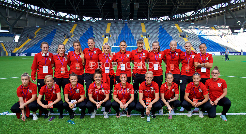 ASTANA, KAZAKHSTAN - Sunday, September 17, 2017: Wales players line-up for a team group photograph before the FIFA Women's World Cup 2019 Qualifying Round Group 1 match between Kazakhstan and Wales at the Astana Arena. Back row L-R: Chloe Lloyd, Emma Beynon, goalkeeper Claire Skinner, goalkeeper Laura O'Sullivan, Charlie Estcourt, Kayleigh Green, Gemma Evans, Alice Griffiths, Rhiannon Roberts, Natasha Harding. Front row L-R: Hannah Miles, Nadia Lawrence, Hayley Ladd, Angharad James, Georgia Evans, captain Sophie Ingle, Jessica Fishlock, Lauren Dykes, Rachel Rowe. (Pic by David Rawcliffe/Propaganda)