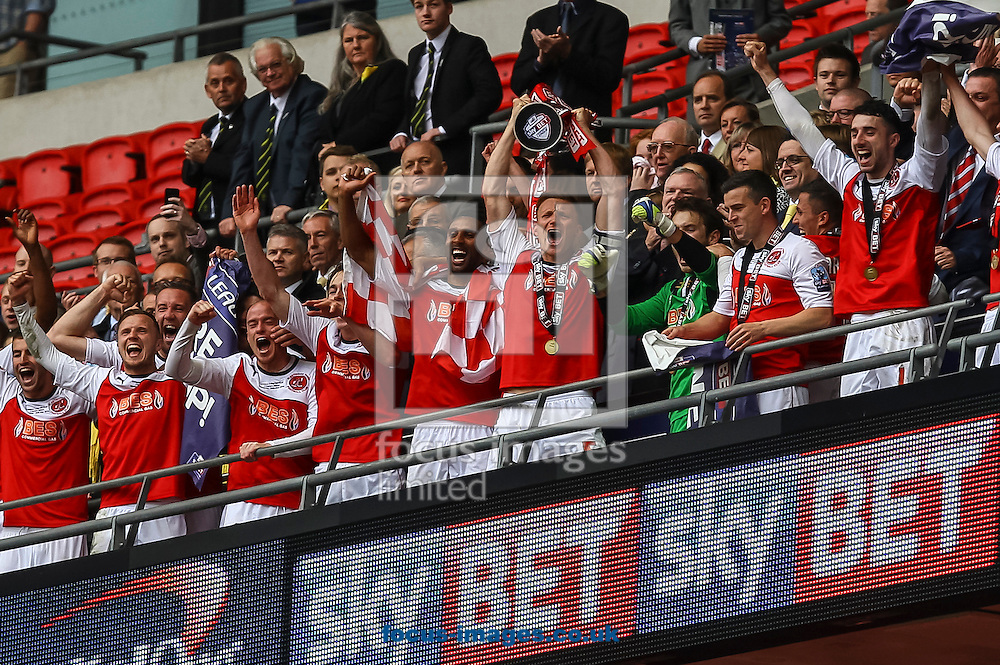 Mark Roberts of Fleetwood Town lifts the trophy after the Sky Bet League 2 match at Wembley Stadium, London<br /> Picture by Daniel Chesterton/Focus Images Ltd +44 7966 018899<br /> 26/05/2014