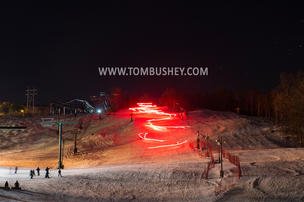 Warwick, New York - A torchlight parade down the mountain was followed by the lighting of sky lanterns to honor former ski patrol member Charlie Both at Mount Peter ski  area on Feb. 28, 2015.