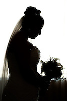 Bride's silhouette captures a quiet moment of solidarity before the wedding.