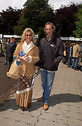 Mike and Angie  Rutherford. Chelsea Flower Show. 19 May 2003. © Copyright Photograph by Dafydd Jones 66 Stockwell Park Rd. London SW9 0DA Tel 020 7733 0108 www.dafjones.com