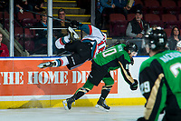 KELOWNA, CANADA - JANUARY 19: Michael Farren #16 of the Kelowna Rockets checks Max Martin #10 of the Prince Albert Raiders during second period on January 19, 2019 at Prospera Place in Kelowna, British Columbia, Canada.  (Photo by Marissa Baecker/Shoot the Breeze)