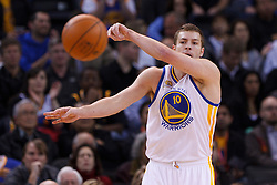 Feb 15, 2012; Oakland, CA, USA; Golden State Warriors power forward David Lee (10) passes the ball against the Portland Trail Blazers during the first quarter at Oracle Arena. Portland defeated Golden State 93-91. Mandatory Credit: Jason O. Watson-US PRESSWIRE