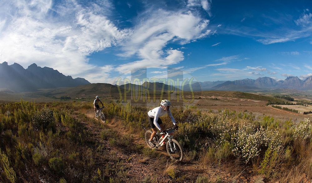 Riders make their waydown the Waaihoeks Berg Mountains  during stage four of the 2010 Absa Cape Epic Mountain Bike stage race from Ceres to Worcester in the Western Cape, South Africa on the 24 March 2010.Photo by Karin Schermbrucker/SPORTZPICS