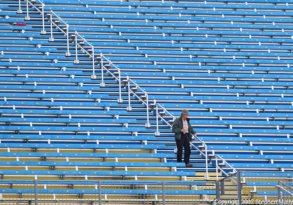 A man makes his way down the stairs as the grandstands are cleared due to a storm system moving in before the start of the IZOD IndyCar Iowa Corn Indy 250 auto race at the Iowa Speedway in Newton, Iowa on Saturday, June 23, 2012.