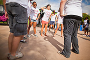 "30 JULY 2011 - PHOENIX, AZ:  Dancers warm up before dancing in a flash mob in Phoenix, AZ. About 200 people showed up at Heritage Square in downtown Phoenix Saturday morning for a flash mob coordinated by the Arizona Science Center. The mob danced to several hip-hop songs before disbanding. The event was a part of National Dance Day Activities and the First Lady's ""Let's Move!"" physical fitness campaign.         PHOTO BY JACK KURTZ"