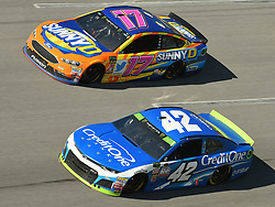 October 14, 2018 - Talladega, AL, U.S. - TALLADEGA, AL - OCTOBER 14: Kyle Larson, Chip Ganassi Racing, Chevrolet Camaro Credit One Bank (42) and Ricky Stenhouse Jr., Roush Fenway Racing, Ford Fusion SunnyD (17) race side by side during the 1000Bulbs.com 500 on October 14, 2018, at Talladega Superspeedway in Tallageda, AL.(Photo by Jeffrey Vest/Icon Sportswire) (Credit Image: © Jeffrey Vest/Icon SMI via ZUMA Press)