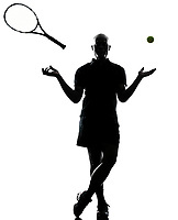 one african afro american man tennis player full length standing throwing ball and racket silhouette on studio isolated on white background