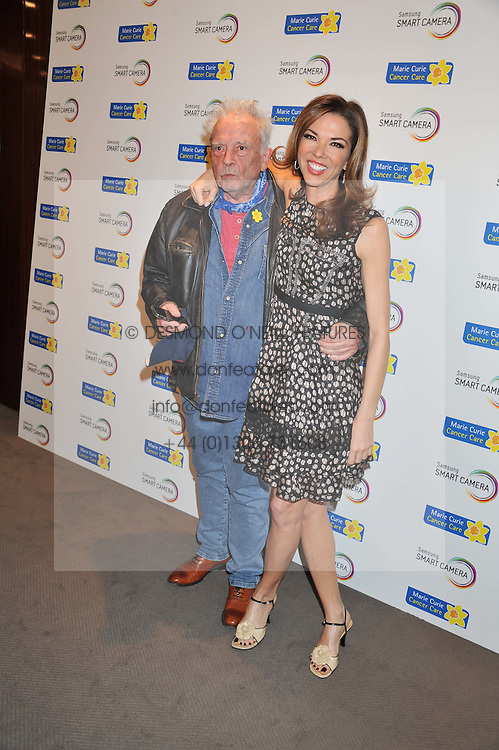 DAVID BAILEY and HEATHER KERZNER at the launch of Samsung's NX Smart Camera at charity auction with David Bailey in aid of Marie Curie Cancer Care at the Bulgari Hotel, 171 Knightsbridge, London on 14th May 2013.