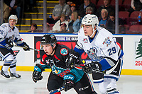 KELOWNA, CANADA - OCTOBER 5:  Brandon Cutler #29 of the Victoria Royals checks Ethan Ernst #19 of the Kelowna Rockets on October 5, 2018 at Prospera Place in Kelowna, British Columbia, Canada.  (Photo by Marissa Baecker/Shoot the Breeze)  *** Local Caption ***