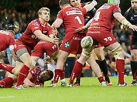 Rugby Union - 2016 / 2017 Pro12 - [Judgement Day V]: Newport Gwent Dragons vs. Scarlets<br /> <br /> Jonathan Evans of Llanelli Scarlets  passes the ball out , at Principality Stadium [Millennium Stadium], Cardiff.<br /> <br /> COLORSPORT/WINSTON BYNORTH