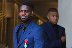 France's national Kylian Mbappe and Samuel Umtiti leaves after receiving the Legion of Honour during a ceremony to award French 2018 football World Cup winners, on June 4, 2019, at the Elysee Palace in Paris. Photo by Raphael Lafargue/ABACAPRESS.COM