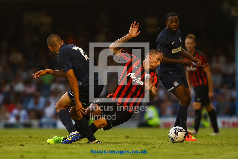 Jack Collison of Queens Park Rangers is fouled by Craig Fagan of Southend United during the pre season friendly match at Roots Hall, Southend<br /> Picture by Daniel Chesterton/Focus Images Ltd +44 7966 018899<br /> 30/07/2014