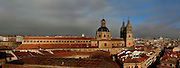 """Panoramic rooftop view of Clerecia Church, Salamanca, Spain, pictured on December 19, 2010 in the afternoon, from the New Cathedral. The Baroque style Clerecia Church, originally the Royal College of the Company of Jesus, was commissioned in the 17th century, from architect Juan Gomez de Mora, by Queen Margarita of Austria, wife of Philip III of Spain. It comprises two sections: the Jesuit school and church, with its three-storey Baroque cloister, and private living quarters for the monks and now houses the Salamanca Pontificia University.  Salamanca, an important Spanish University city, is known as La Ciudad Dorada (""""The golden city"""") because of the unique golden colour of its Renaissance sandstone buildings. Founded in 1218 its University is still one of the most important in Spain. Around it the Old Town is a UNESCO World Heritage Site. Picture by Manuel Cohen"""