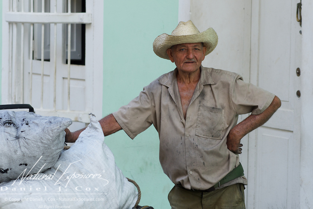 A local Cuban man selling coal on the streets of Trinidad, Cuba.
