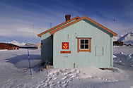 Northernmost post office in the world at the international science village of Ny-Alesund sits amid April snows on Spitsbergen island in Kongsfjorden; Svalbard, Norway.